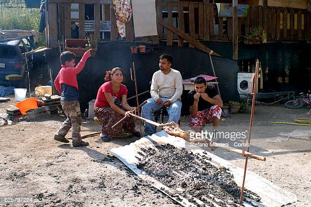 Roma bosnian family cooking a lamb for lunch to the Rom's camp Casilino 900 on May 6 2008 in Rome Italy Field abusive nomad is one of the largest in...