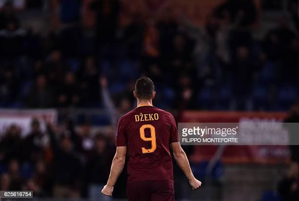 Roma Bosnian forward Edin Dzeko celebrates after scoring during the Europa League football match Roma vs Viktoria Plzen at the Olympic Stadium in...