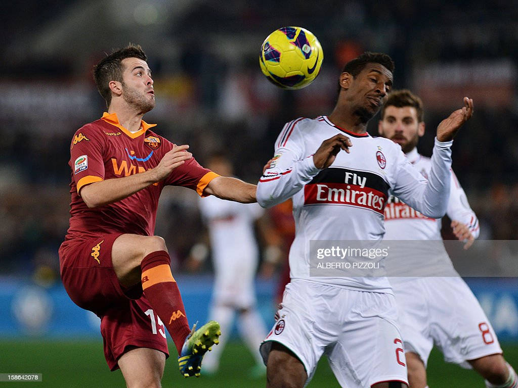 AS Roma Bosnian midfielder Miralem Pjanic (L) vies for the ball with AC Milan's Colombian midfielder Kevin Constant during the Italian Serie A football match between AS Roma and AC Milan on December 22, 2012, at the Olympic stadium in Rome.