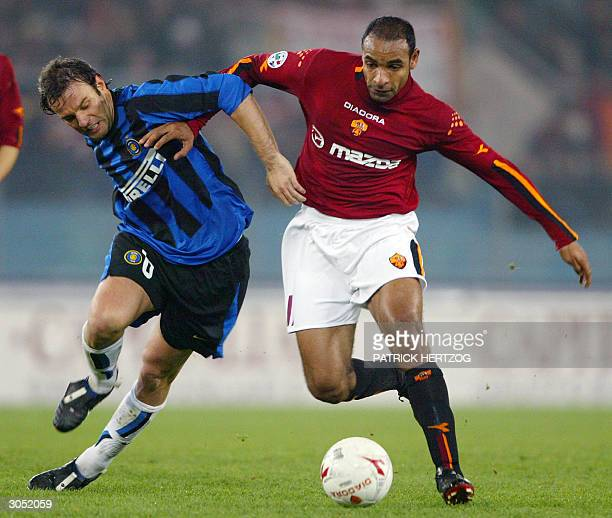 Roma Brazilian midfielder Emerson vies with Inter Milan's Christian Zanetti in a Serie A match at Rome Olympic stadium 07 March 2004 Roma won 41