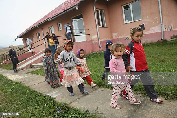 Roma children head home after attending a preschool class in the abjectly poor Roma settlement of Ponorata on September 10 2013 in Ponorata Romania A...