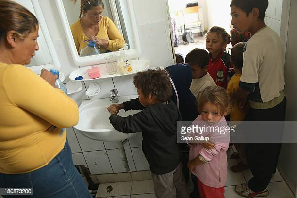Roma children line up to wash their hands prior to snacktime at a preschool class in the abjectly poor Roma settlement of Ponorata on September 10...