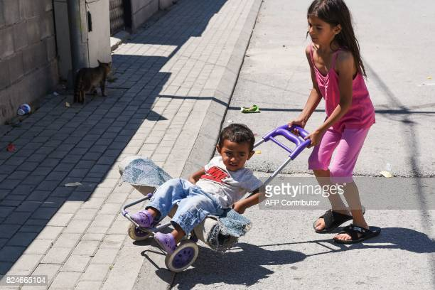 Roma children play on the street in the Roma neighborhood in the town of Mitrovica on July 7 2017 The Roma 'are not treated like humans' Florim...