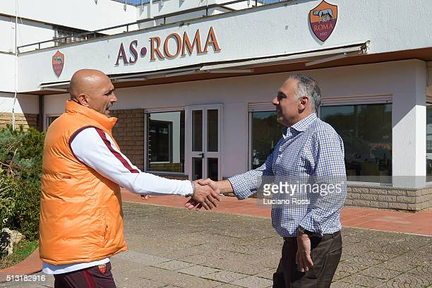 Roma coach Luciano Spalletti greets AS Roma President James Pallotta before an AS Roma training session on March 1 2016 in Rome Italy