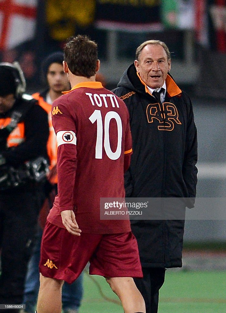 AS Roma coach Zdenek Zeman (R) greets AS Roma forward Francesco Totti as he leaves the field during the Italian Serie A football match between AS Roma and AC Milan on December 22, 2012, at the Olympic stadium in Rome.