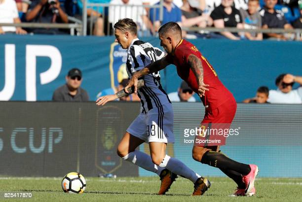 Roma defender Aleksandar Kolarov tries to slow down Juventus forward Federico Bernardeschi during an International Champions Cup match between AS...