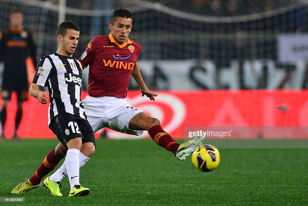 AS Roma defender Marquinhos (R) fights for the ball with Juventus' forward Sebastian Giovinco during the Italian Serie A football match between AS Roma and Juventus on February 16, 2013 at the Olympic Stadium in Rome.