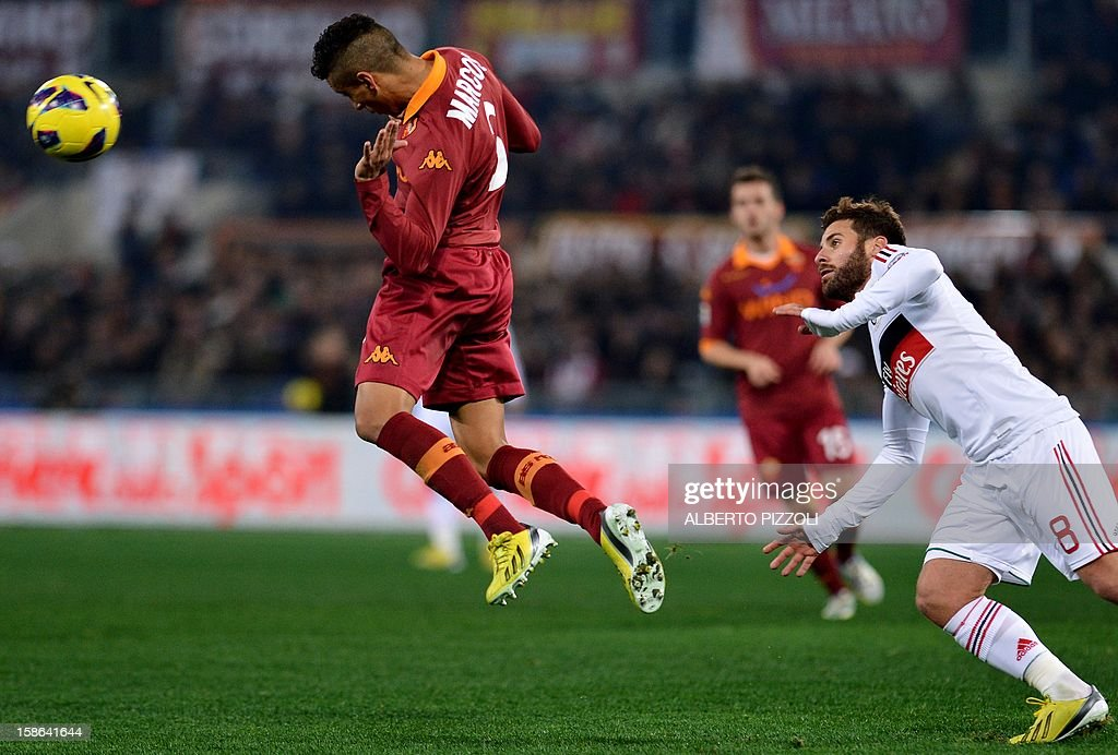 AS Roma defender Marquinhos (L) heads the ball in front of AC Milan's midfielder Antonio Nocerino during the Italian Serie A football match between AS Roma and AC Milan on December 22, 2012, at the Olympic stadium in Rome.