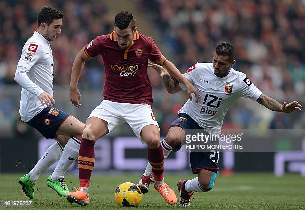 AS Roma Dutch forward Kevin Strootman vies with Genoa's defender Stefan Simic and Genoa's midfielder Davide Biondini during their Italian Serie A...