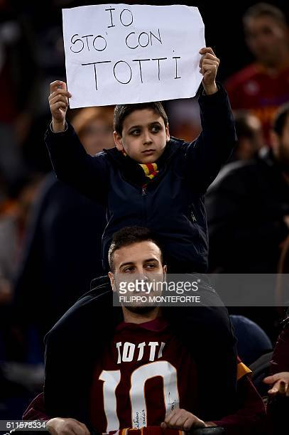 AS Roma fan holds a banner reading 'I'm with Totti' in support to Italy's Roma forward Francesco Totti during the italian Serie A football match Roma...