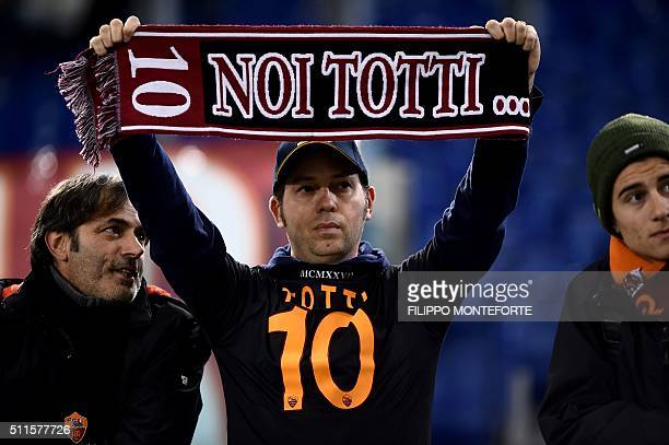 AS Roma fan holds a scarf reading 'We Totti' in support to Italy's Roma forward Francesco Totti during the italian Serie A football match Roma vs...