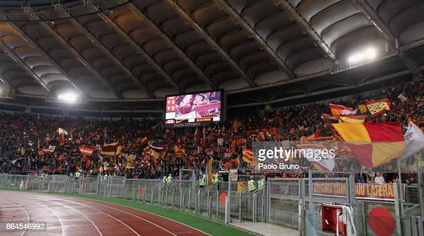 Roma fans support their team before the TIM Cup match between AS Roma and SS Lazio at Stadio Olimpico on April 4 2017 in Rome Italy
