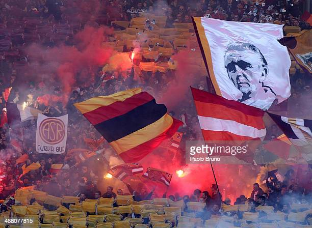 Roma fans support their team during the Serie A match between SS Lazio and AS Roma at Stadio Olimpico on February 9 2014 in Rome Italy
