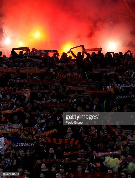 Roma fans support their team during the TIM Cup match between AS Roma and Juventus FC at Olimpico Stadium on January 21 2014 in Rome Italy