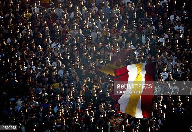 Roma fans wave a flag with the AS Roma's colour during AS Roma vs Reggina Serie A soccer match at Rome's Olympic stadium 02 November 2003 AFP PHOTO...