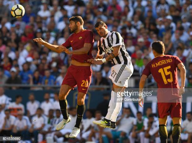 Roma Federico Fazio vies for the ball against Juventus FC Stefano Sturaro during their 2017 International Champions Cup match at Gillette Stadium in...