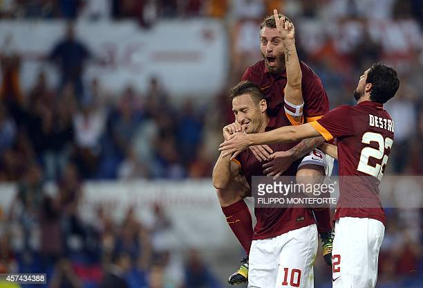 AS Roma forward and captain Francesco Totti celebrates with teammates Daniele De Rossi and Mattia Destro after scoring during the Italian Serie A...
