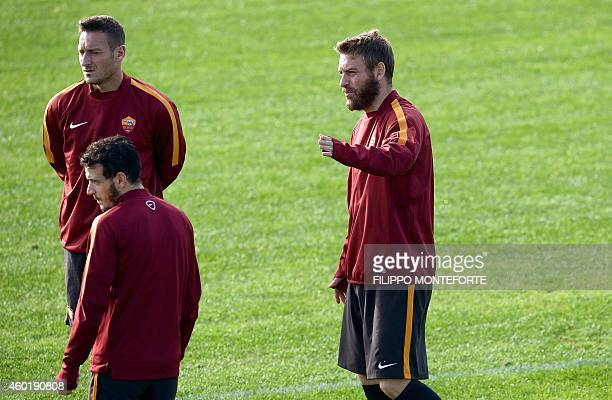 AS Roma forward and captain Francesco Totti midfielder Alessandro Florenzi and midfielder Daniele De Rossi attend a training session on the eve of...