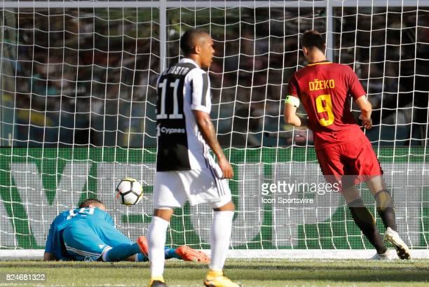 Roma forward Edin Dzeko beats Juventus goalkeeper Carlo Pinsoglio during an International Champions Cup match between AS Roma and Juventus on July 30...