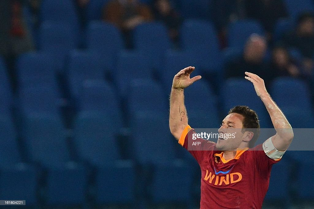 AS Roma forward Francesco Totti celebrates after scoring a goal during the Italian Serie A football match between AS Roma and Juventus on February 16, 2013 at the Olympic Stadium in Rome.