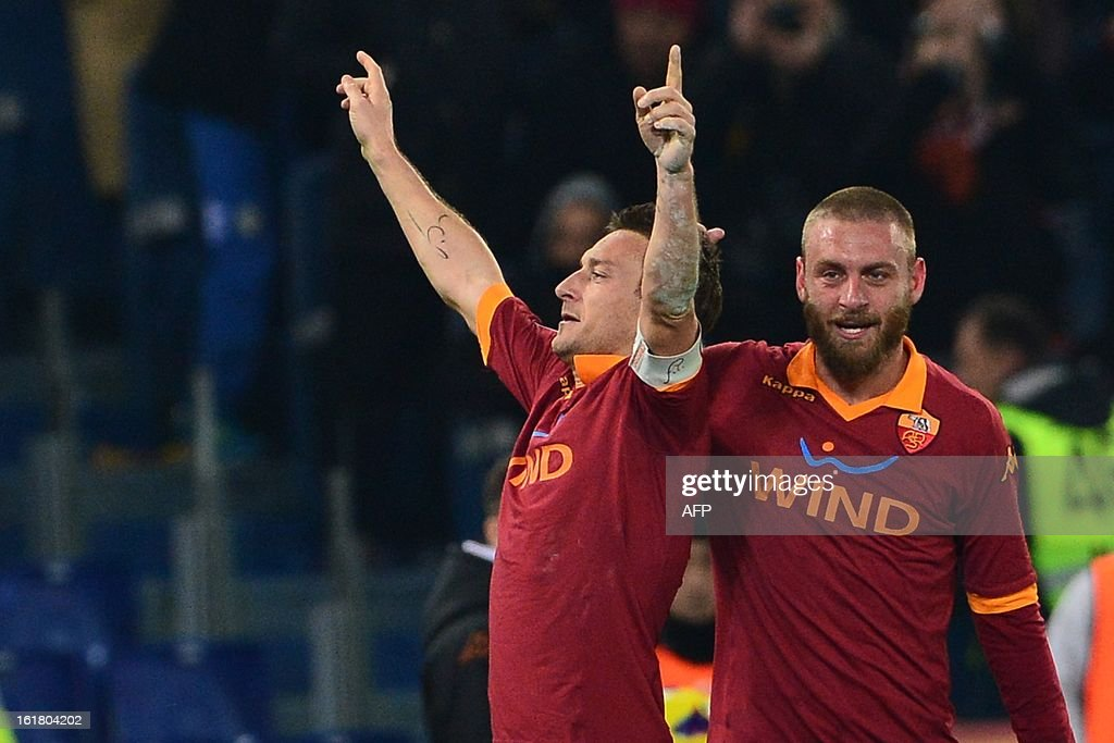 AS Roma forward Francesco Totti (L) celebrates after scoring a goal with AS Roma midfielder Daniele De Rossi during the Italian Serie A football match between AS Roma and Juventus on February 16, 2013 at the Olympic Stadium in Rome.
