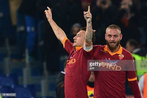 AS Roma forward Francesco Totti celebrates after scoring a goal with AS Roma midfielder Daniele De Rossi during the Italian Serie A football match...