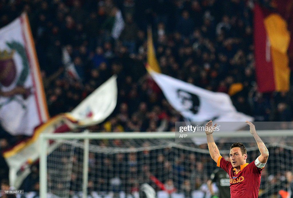 AS Roma forward Francesco Totti celebrates scoring a goal during the Italian Serie A football match between AS Roma and Juventus on February 16, 2013 at the Olympic Stadium in Rome.