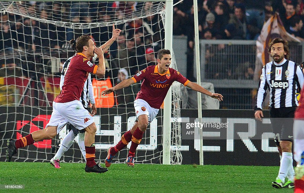 AS Roma forward Francesco Totti (L) celebrates scoring a goal with with AS Roma Argentine forward Erik Lamela (C) during the Italian Serie A football match between AS Roma and Juventus on February 16, 2013 at the Olympic Stadium in Rome.