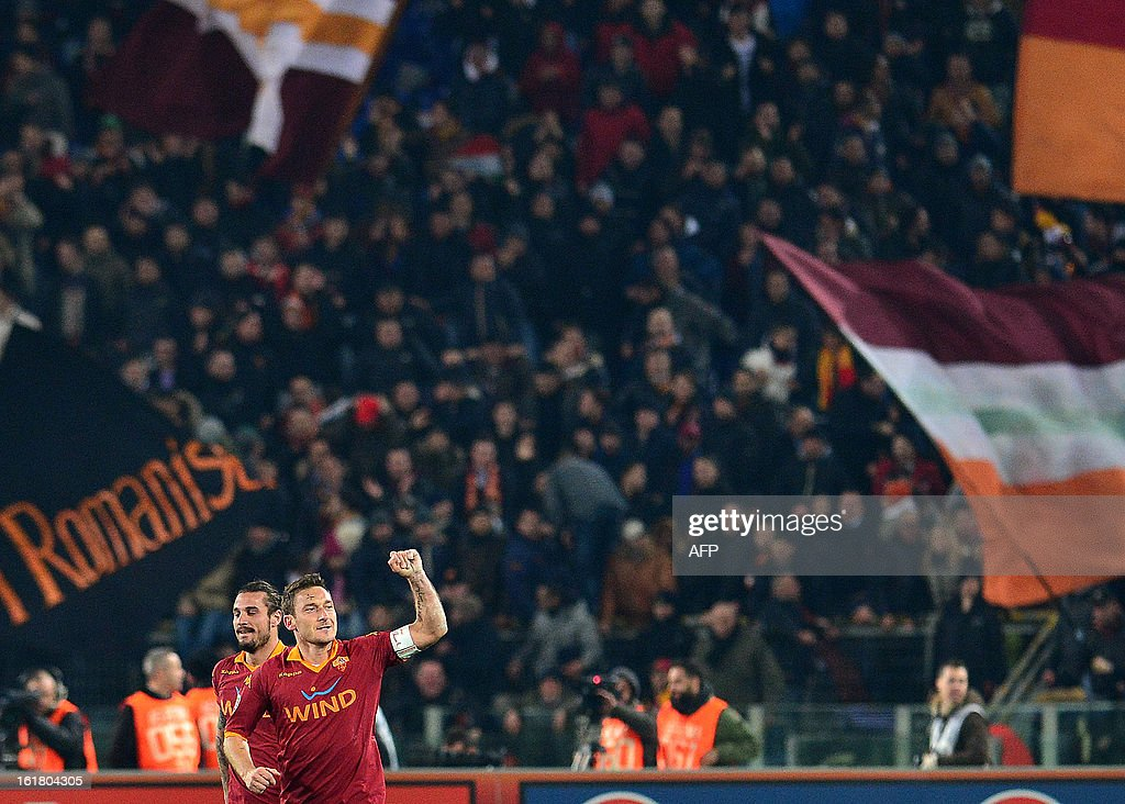 AS Roma forward Francesco Totti (R) celebrates scoring a goal with with AS Roma Argentine forward Erik Lamela (C) during the Italian Serie A football match between AS Roma and Juventus on February 16, 2013 at the Olympic Stadium in Rome.