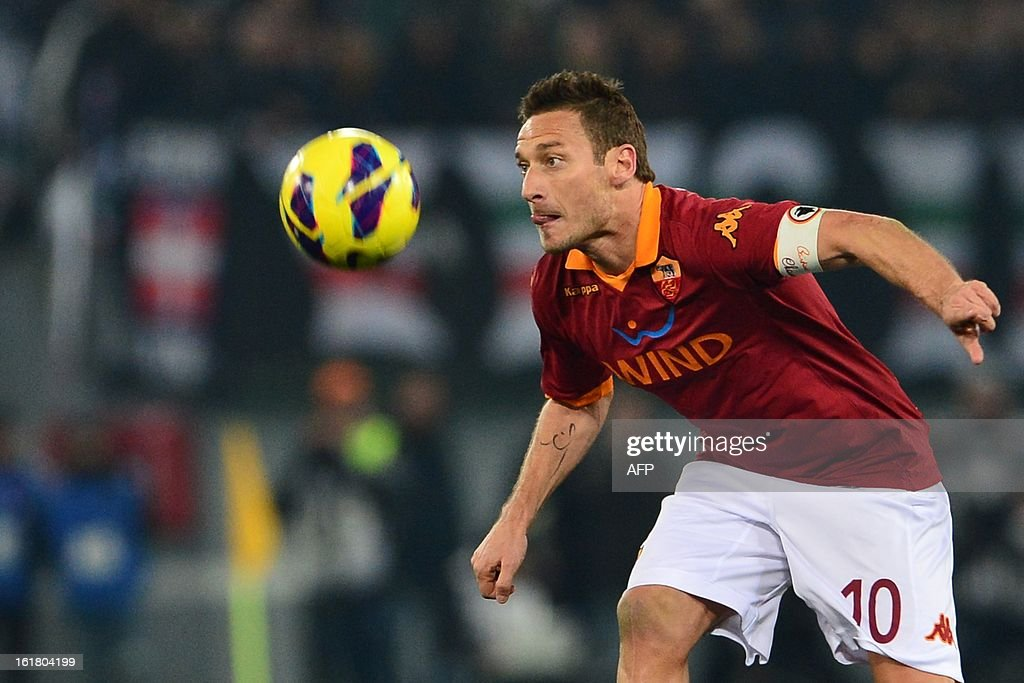 AS Roma forward Francesco Totti eyes the ball during the Italian Serie A football match between AS Roma and Juventus on February 16, 2013 at the Olympic Stadium in Rome.
