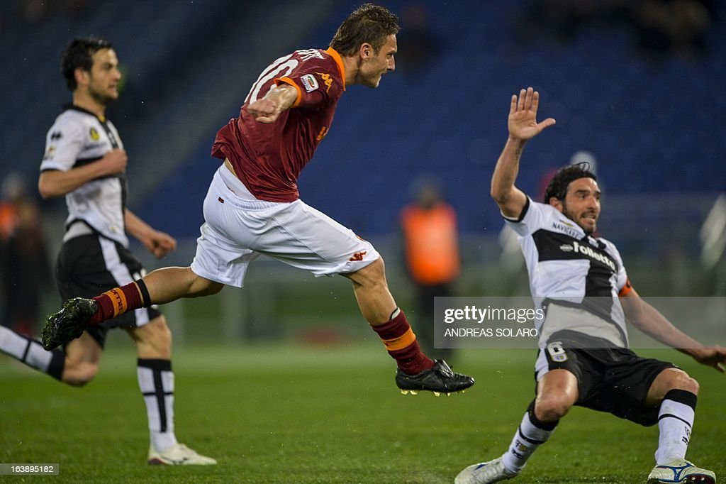 AS Roma forward Francesco Totti (C) kicks the ball during the Italian Serie A football match AS Roma vs. Parma on March 17, 2013 at Rome's Olympic stadium.