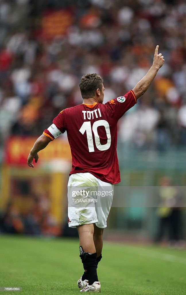 AS Roma forward <a gi-track='captionPersonalityLinkClicked' href=/galleries/search?phrase=Francesco+Totti&family=editorial&specificpeople=208985 ng-click='$event.stopPropagation()'>Francesco Totti</a> reacts after Roma scored against Juventus during their Italian Serie A football match at Olympic stadium in Rome 23 September 2007. AFP PHOTO /TizianaFabi