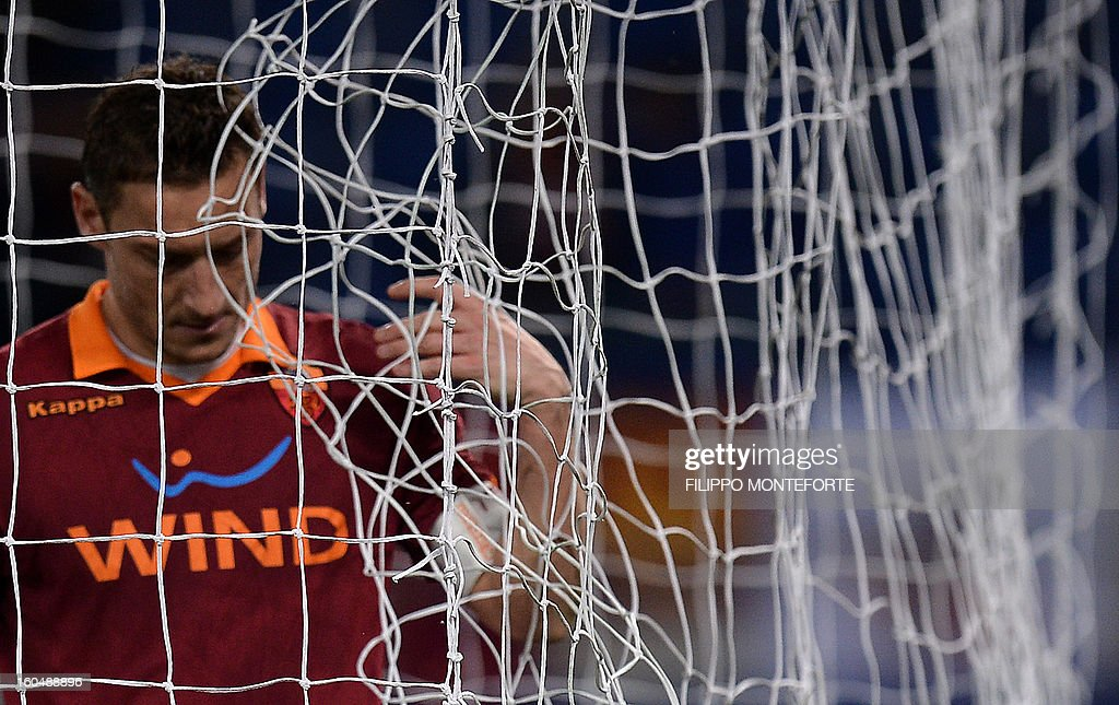 AS Roma forward Francesco Totti reacts against Cagliari after losing 4-2during the Serie A football match AS Roma vs Cagliari in Rome's Olympic Stadium on Febuary 1, 2013.