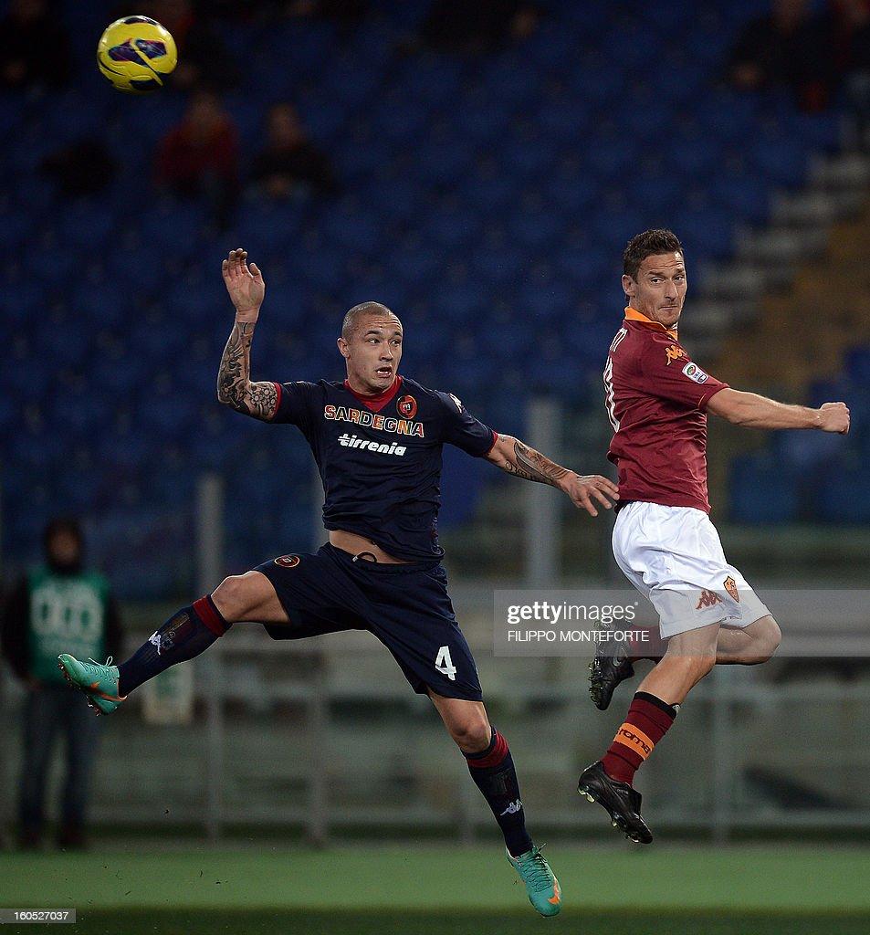 AS Roma forward Francesco Totti (R) vies with Cagliari's midfielder Radja Nainggola during the Serie A football match AS Roma vs Cagliari in Rome's Olympic Stadium on Febuary 1, 2013. AFP PHOTO / FILIPPO MONTEFORTE