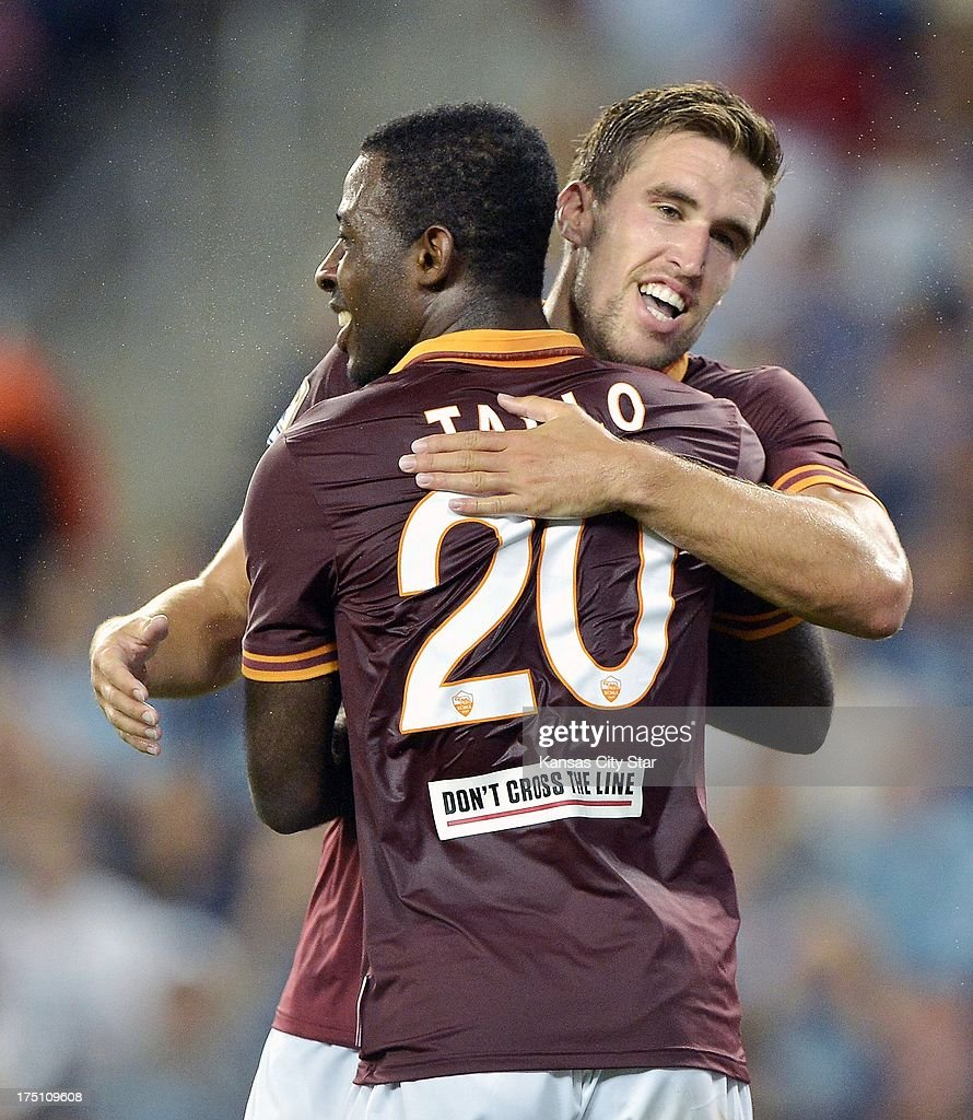 AS Roma forward Junior Tallo (20) is congratulated by teammate Kevin Strootman after Tallo scored in the second half against the MLS All-Star team on Wednesday, July 31, 2013, at Sporting Park in Kansas City, Kansas. Roma won, 3-1.