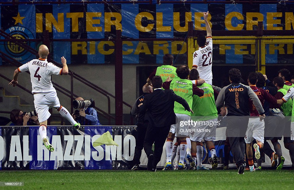 AS Roma forward Mattia Destro (Top R) cheer supporters as he celebrates with teammates after scoring during the semi final second leg football match between Inter Milan and AS Roma, on April 17, 2013 in Milan, at the San Siro stadium . AFP PHOTO / OLIVIER MORIN