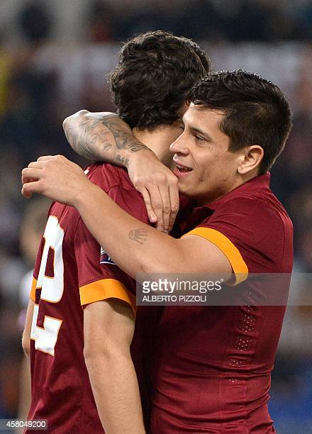 AS Roma forward Mattia Destro is congratulated by teammate AS Roma Argentinian forward Juan Manuel Iturbe after scoring during the Italian Serie A...