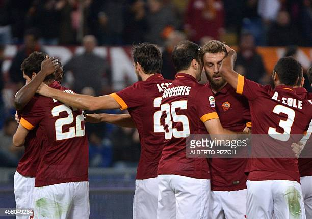 AS Roma forward Mattia Destro is congratulated by teammates after scoring during the Italian Serie A football match As Roma vs Cesena on October 29...