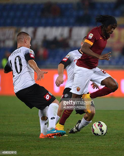 AS Roma forward of Ivory Coast Gervinho passes by Cesena's players during the Italian Serie A football match As Roma vs Cesena on October 29 2014 at...