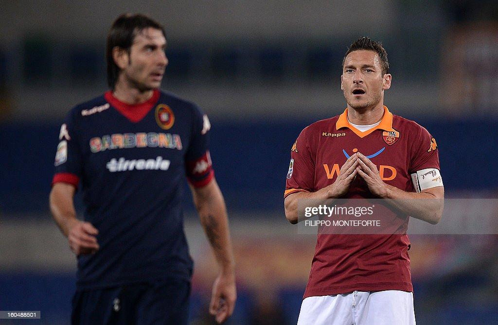 AS Roma Francesco Totti (R) reacts against Cagliari midfielder Daniele Conti during the Serie A football match AS Roma vs Cagliari in Rome's Olympic Stadium on Febuary 1, 2013.