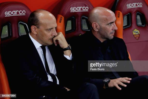 AS Roma General Director Mauro Baldissoni and Sport Director Monchi speak during the Serie A match between AS Roma and FC Internazionale on August 26...