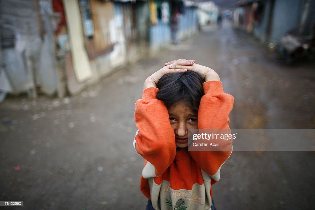 A Roma girl covers up in the Cesmin Lug refugee camp in the Serbian district December 12, 2007 in Kosovo province, Serbia. One hundred and fourty-four refugees live in the camp near toxic metal waste left by the Trepca mines, living in extremely poor conditions with no running water. Members of the Roma minority were forced to flee their homes in the Mahala district in southern Mitrovica during the Kosovo war in the 1999. They settled in the Serb-populated northern side of the divided province. Were independence to come to Kosovo, the north would continue as a Serbian enclave. Kosovo, administered by the United Nations since the 1990 conflict, is home to approximately 120,000 Serbs, who face an uncertain future should the province, with its majority Albanian population, become independent under a U.N. proposed plan.