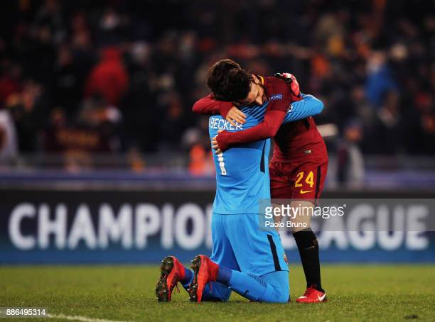 Roma goalkeeper Alisson Becker and Alessandro Florenzi celebrate the victory after the UEFA Champions League group C match between AS Roma and...