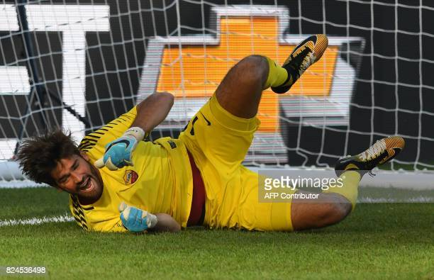 Roma goalkeeper Alisson Becker dives to stop a ball during penalty kicks against Juventus FC during their 2017 International Champions Cup match at...