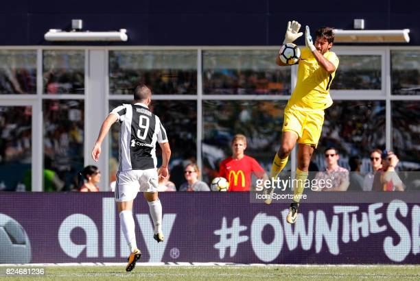 Roma goalkeeper Alisson stops the shot from Juventus forward Gonzalo Higuain during an International Champions Cup match between AS Roma and Juventus...