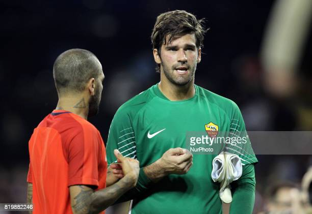 Roma goalkeeper Alisson talks to Paris SaintGermain Dani Alves after the game during an International Champions Cup match at Comerica Park in Detroit...