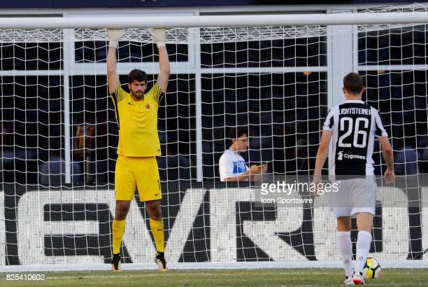 Roma goalkeeper Alisson tries to gauge Juventus defender Stephan Lichtsteiner during an International Champions Cup match between AS Roma and...
