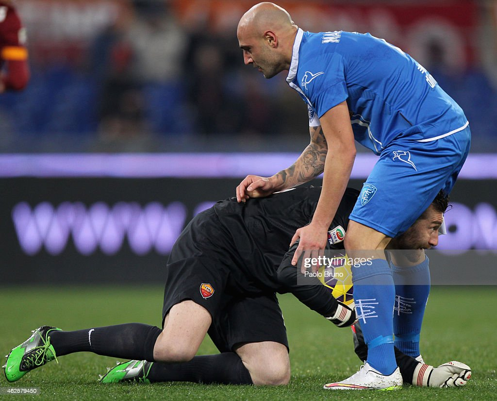 Roma goalkeeper <a gi-track='captionPersonalityLinkClicked' href=/galleries/search?phrase=Morgan+De+Sanctis&family=editorial&specificpeople=615695 ng-click='$event.stopPropagation()'>Morgan De Sanctis</a> and <a gi-track='captionPersonalityLinkClicked' href=/galleries/search?phrase=Massimo+Maccarone&family=editorial&specificpeople=204389 ng-click='$event.stopPropagation()'>Massimo Maccarone</a> of Empoli FC react during the Serie A match between AS Roma and Empoli FC at Stadio Olimpico on January 31, 2015 in Rome, Italy.