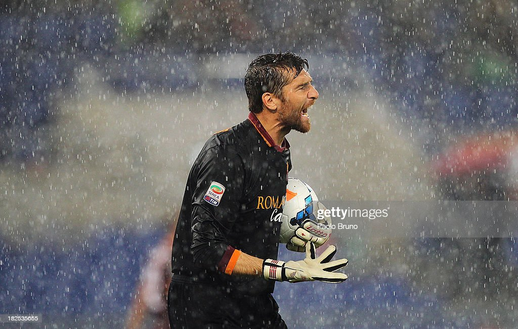 AS Roma goalkeeper <a gi-track='captionPersonalityLinkClicked' href=/galleries/search?phrase=Morgan+De+Sanctis&family=editorial&specificpeople=615695 ng-click='$event.stopPropagation()'>Morgan De Sanctis</a> reacts during the Serie A match between AS Roma and Bologna FC at the Stadio Olimpico on September 29, 2013 in Rome, Italy.