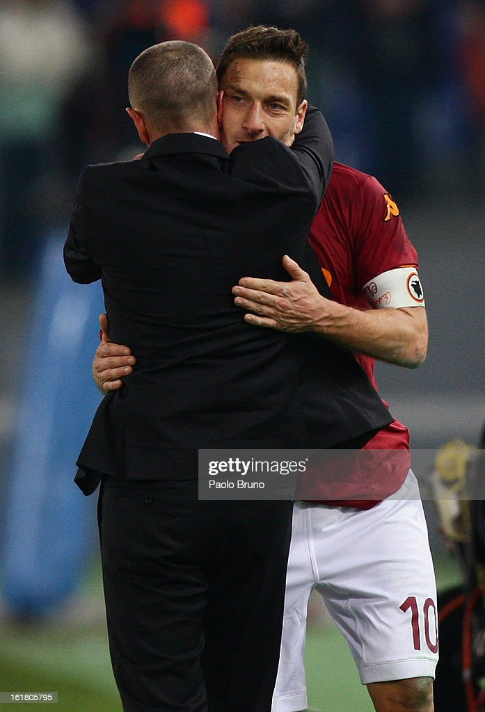 AS Roma head coach Aurelio Andreazzoli embraces goal-scorer Francesco Totti during the Serie A match between AS Roma and Juventus FC at Stadio Olimpico on February 16, 2013 in Rome, Italy.